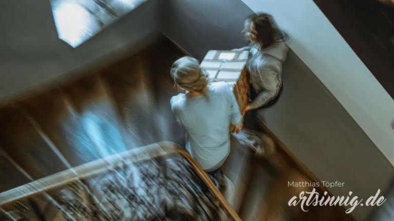 Kunstfotografie Menschen beim Umzug Fotodesign